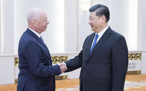 President Xi meets Schwab, vows greater opening up