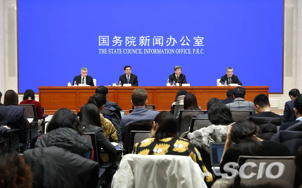 Chinese economic officials elaborate policies to boost growth